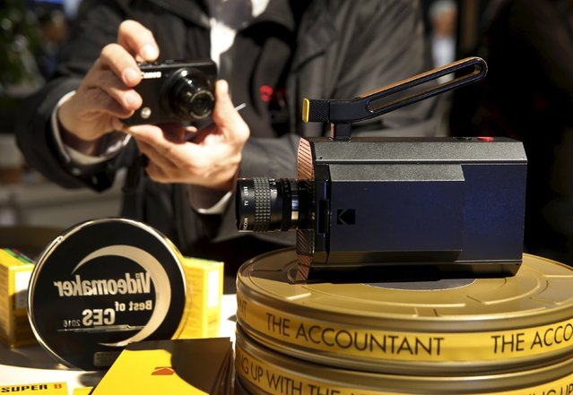 A man takes a photo of the prototype Kodak Super 8 film movie camera with electronic viewfinder during the 2016 CES trade show in Las Vegas, Nevada January 8, 2016. (Photo by Steve Marcus/Reuters)