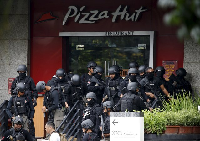 "Police gather outside a restaurant near the scene of an attack in central Jakarta January 14, 2016. Militants launched a gun and bomb assault in the center of the Indonesian capital on Thursday, killing at least six people, in an attack that followed a threat by Islamic State fighters to put the country in their ""spotlight,"" police said. (Photo by Reuters/Beawiharta)"
