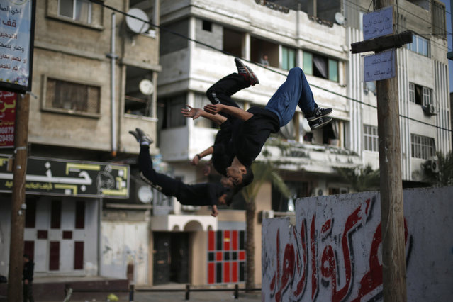 Palestinian youths demonstrate their parkour skills on a street in Gaza City, January 15, 2016. (Photo by Suhaib Salem/Reuters)