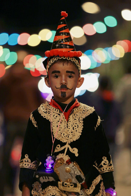 A boy wearing a folk costume takes part in a procession celebrating the religious holiday of Mawlid al-Nabi, the birthday of Prophet Mohammad, in Benghazi, Libya December 10, 2016. (Photo by Esam Omran Al-Fetori/Reuters)