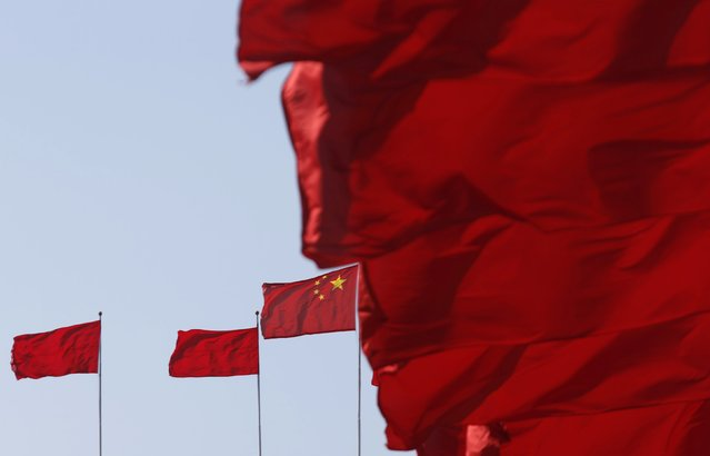 Flags flutter ahead of the opening session of Chinese People's Political Consultative Conference (CPPCC) at Tiananmen Square in Beijing, March 3, 2015.  REUTERS/Kim Kyung-Hoon