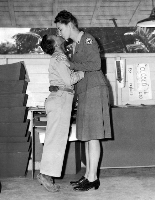 A former showgirl, Elizabeth Johnstone of Minneapolis, who is with the Red Cross in New Caledonia, gives little Jackie Heller of Pittsburgh a kiss on May 18, 1944. It was to celebrate his birthday and his first year overseas with a USO entertainment unit. Jackie is five feet, one inch: Miss Johnstone, a University of Minnesota graduate in the '43 class, is six feet. She was in Billy Rose's Aquacade and in the Earl Carroll Vanities. (Photo by Frank Filan/AP Photo)