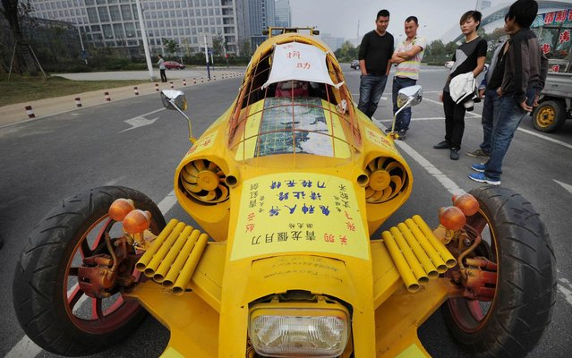 A car made from parts taken from used vehicles is shown in street Hefei, Anhui Province in China, on Oktober 21, 2013. The machine, which reaches 60 km/h, is the brainchild of self-taught inventor Zhu Runqiang. (Photo by Reuters/China Daily)