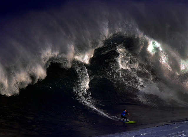 A surfer rides a large wave at El Bocal during the Vaca Gigante (Big Cow) giant wave surf competition in Santander, northern Spain December 17, 2016. (Photo by Vincent West/Reuters)