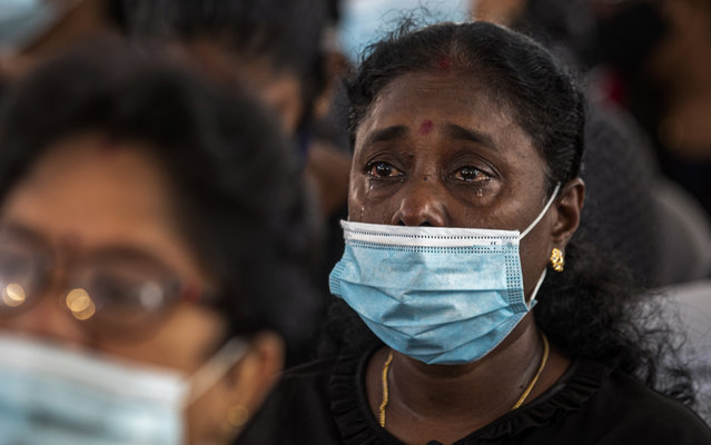 A Sri Lankan woman weeps during a memorial service for the victims of 2019 Easter Sunday attacks at St. Anthony's Church in Colombo, Sri Lanka, Wednesday, April 21, 2021. Wednesday marked the second anniversary of the serial blasts that killed 269 people. (Photo by Eranga Jayawardena/AP Photo)