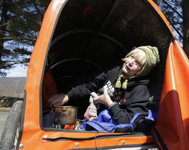 "Sixty-eight year old cross-country runner Rosie Swale-Pope is interviewed while sitting in her cart, ""The Icebird"", in Upperville, Virginia March 13, 2015. (Photo by Gary Cameron/Reuters)"