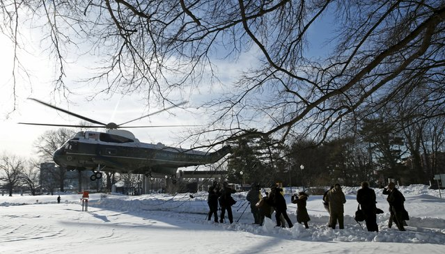 Members of the media try to hold their ground as Marine One lands beside them upon its arrival with U.S. President Barack Obama at the Walter Reed National Military Medical Center in Bethesda, Maryland January 25, 2016. Obama was flown here to meet with wounded service personnel. (Photo by Kevin Lamarque/Reuters)