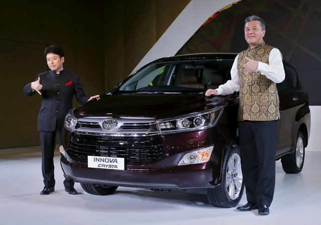 Toyota Kirloskar Motor's Managing Director Naomi Ishii and Chief Executive Engineer Hiroki Nakajima (R) pose with their new Innova car during its launch at the Indian Auto Expo in Greater Noida, on the outskirts of New Delhi, India, February 3, 2016. (Photo by Anindito Mukherjee/Reuters)
