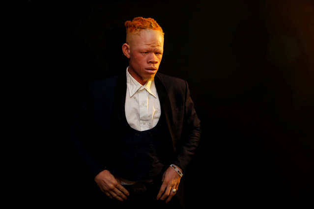 A participant waits back stage before getting on the catwalk during the Mr & Miss Albinism Kenya Beauty Pageant 2018 in Nairobi, Kenya, November 30, 2018. (Photo by Baz Ratner/Reuters)