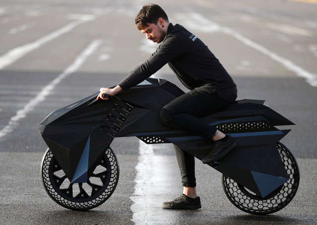 Designer Marco Mattia Cristofori of the German 3D printer manufacturer BigRep, stands with his nearly completely 3D printed e-motorcycle NERA, at the airfield Tempelhof in Berlin, Germany, December 3, 2018. Picture taken December 3, 2018. (Photo by Hannibal Hanschke/Reuters)