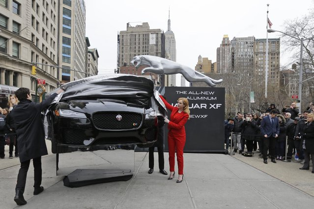 Actress Christina Hendricks, right, unveils the new Jaguar all-aluminum XF sedan at Flat Iron Square ahead of its debut at the New York International Auto Show, Tuesday, March 31, 2015, in New York. (Photo by Mary Altaffer/AP Photo)