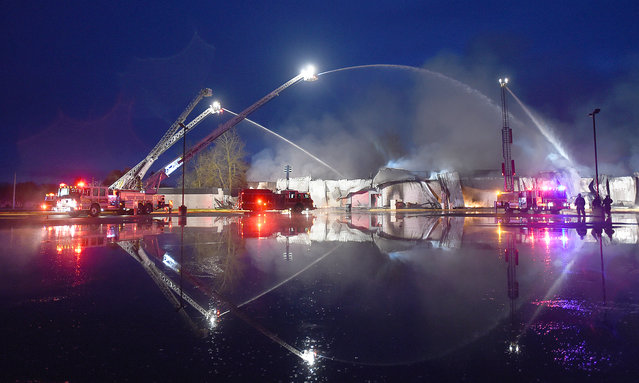 Ladder trucks from Lebanon, Ore., Corvallis, Ore., and Albany, Ore., battle a 4-alarm fire that destroyed the cafeteria of South Albany High School, early Wednesday, April 1, 2015. There was no immediate report of injuries or what caused the fire. (Photo by Mark Ylen/AP Photo/Albany Democrat-Herald)