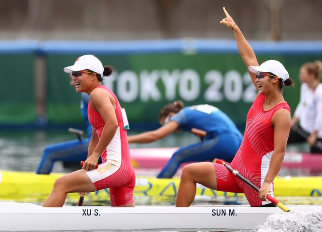 China's Xu Shixiao and Sun Mengya celebrate after winning the women's canoe double 500 meters at the Tokyo Olympics on August 7, 2021, at Sea Forest Waterway in Tokyo. (Photo by Yara Nardi/Reuters)