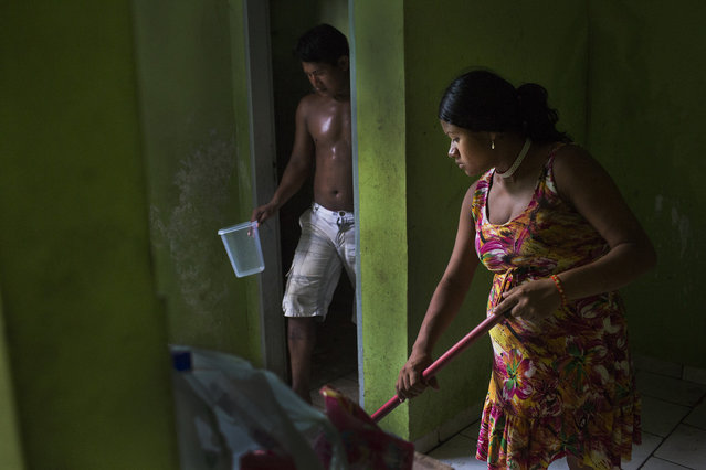 A Xikrin couple clean a very dirty apartment in a housing space for indigenous visitors in Altamira. Many of members of the Xikrin indigenous tribe complain that they were not consulted about the dam despite a constitutional obligation to do so. (Taylor Weidman)