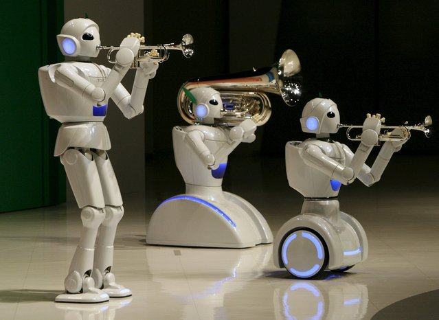 Toyota Motor Corp's partner robots play instruments at the company's showroom in Tokyo, in this May 4, 2008 file photo. (Photo by Toru Hanai/Reuters)