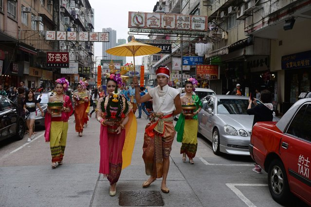 Performers take part in a parade to celebrate the Songkran festival in Hong Kong on April 12, 2015. (Photo by Dale de la Rey/AFP Photo)