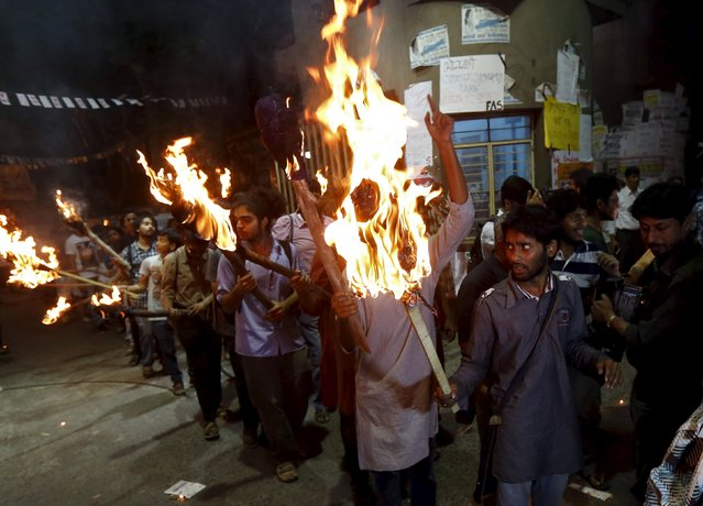 Students hold torches as they shouts slogans during a protest rally inside the Jadavpur University campus in Kolkata, India, February 23, 2016. The demonstration was held in solidarity with Jawaharlal Nehru University (JNU) after the head of JNU's students union was arrested for sedition, according to the organisers. (Photo by Rupak De Chowdhuri/Reuters)