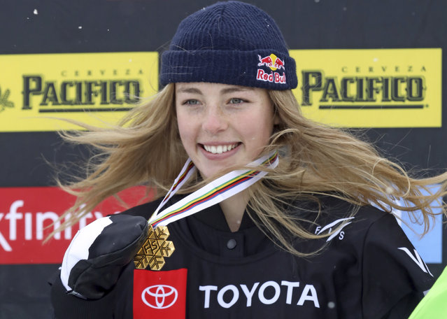 First-place finisher Zoi Sadowski-Synnott, of New Zealand, celebrates on the podium following the women's slopestyle snowboard world championship Sunday, February 10, 2019, in Park City, Utah. (Photo by Rick Bowmer/AP Photo)