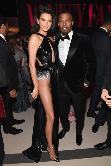 Kendall Jenner (L) and Jamie Foxx attend the 2019 Vanity Fair Oscar Party hosted by Radhika Jones at Wallis Annenberg Center for the Performing Arts on February 24, 2019 in Beverly Hills, California. (Photo by Kevin Mazur/VF19/WireImage)