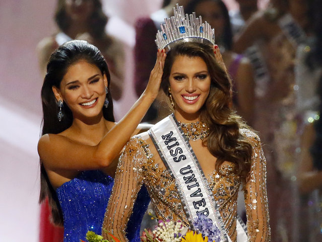 Iris Mittenaere of France is crowned the new Miss Universe 2016 by 2015 Miss Universe Pia Wurtzbach in coronation Monday, January 30, 2017, at the Mall of Asia in suburban Pasay city, south of Manila, Philippines. (Photo by Bullit Marquez/AP Photo)