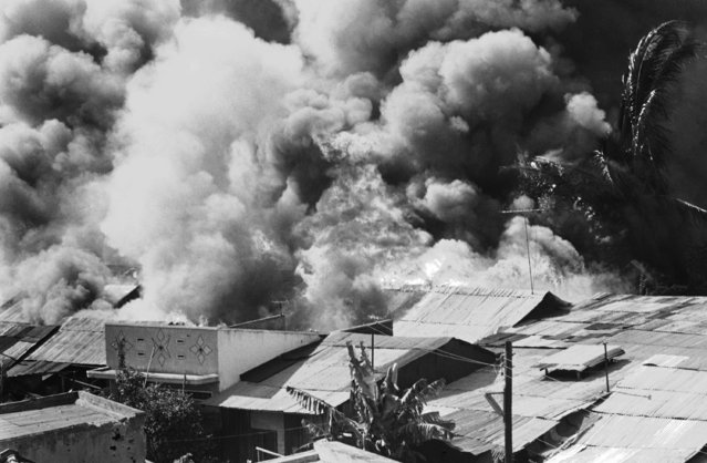 Fire rages in residential area of Xuan Loc, Vietnam on Thursday, April 11, 1975, as fighting erupted between South Vietnamese troops and Dommunist forces. The city in 40 miles form Saigon (Photo by AP Photo/CAU)
