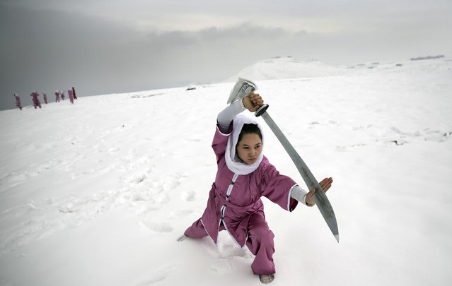 A Shaolin martial arts student practices on a hilltop in Kabul, Afghanistan, Tuesday, January 25, 2017. The students are preparing for the day that Afghanistan can send its women's team to the Shaolin world championship in China. (Photo by Massoud Hossaini/AP Photos)