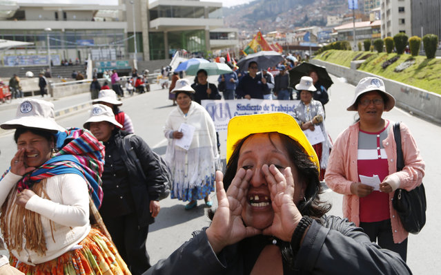 Bricklayers shout labor day slogans as they take part in a May Day march, in La Paz, Bolivia, Friday, May 1, 2015. Left-wing groups, governments and trade unions were staging rallies around the world Friday to mark International Workers Day, also known as May Day. (Photo by Juan Karita/AP Photo)
