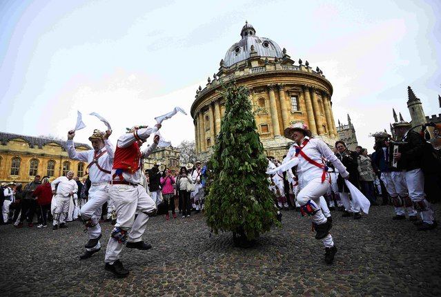 Morris Dancers celebrate beside the Radcliffe Camera in the early hours during traditional May Day celebrations in Oxford, Britain, May 1, 2015. (Photo by Dylan Martinez/Reuters)