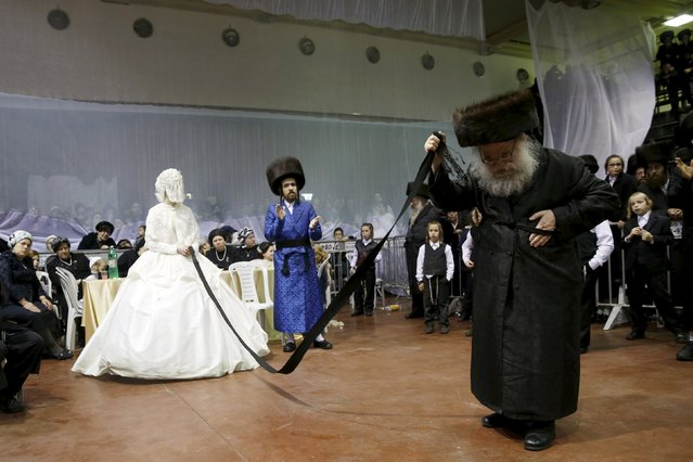 "An ultra-Orthodox Jewish bride takes part in the ""mitzva tantz"", the custom in which relatives dance in front of the bride after her wedding ceremony, in Netanya, Israel, early March 16, 2016. (Photo by Baz Ratner/Reuters)"