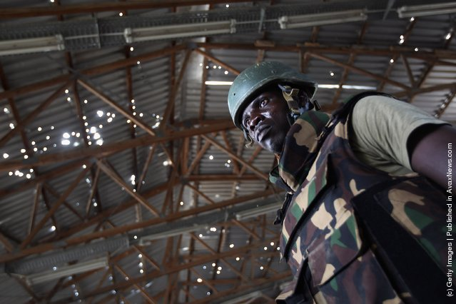 A Ugandan soldier stands in a bomb making warehouse in Mogadishu, Somalia