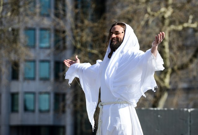 "Actor James Burke-Dunsmore appears resurrected whilst playing Jesus during The Wintershall's ""The Passion of Jesus"" in front of crowds on Good Friday at Trafalgar Square on March 25, 2016 in London, England. (Photo by Chris Ratcliffe/Getty Images)"