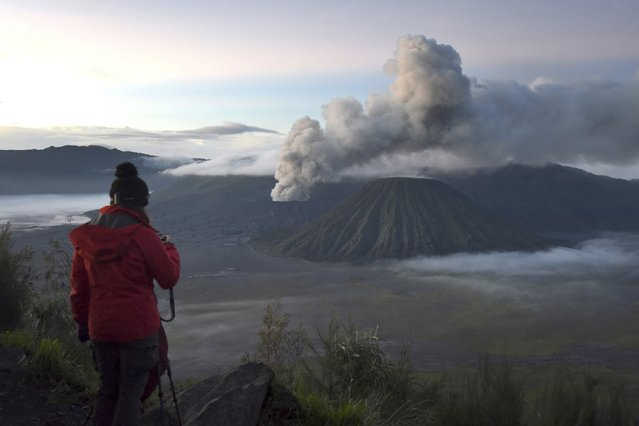 A visitor takes photographs of Mount Bromo, an active volcano and popular tourist destination, in Probolinggo, East Java province, Indonesia April 3, 2016 in this photo taken by Antara Foto. (Photo by Zabur Karuru/Reuters/Antara Foto)