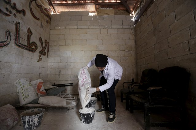 Khamis, 24, pours gypsum in a bucket to make a mould for an artificial limb inside a workshop in the rebel-controlled area of Maaret al-Numan town in Idlib province, Syria March 20, 2016. (Photo by Khalil Ashawi/Reuters)