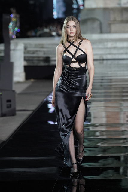 Gigi Hadid walks the runway, wearing Versace, at the CR runway x LUISAVIAROMA 90th Anniversary Show during Pitti Immagine Uomo 96 on June 13, 2019 in Florence, Italy. (Photo by Vittorio Zunino Celotto/Getty Images for LuisaViaRoma)