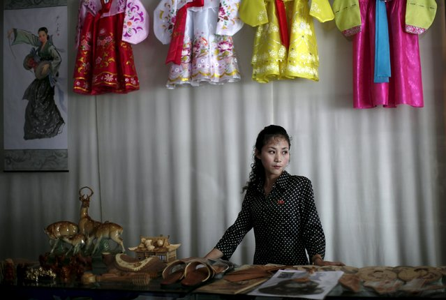 A woman stands in a gift shop in central Rason city, part of the special economic zone northeast of Pyongyang, in this August 30, 2011 file photo. North Korea is a militarized, male-dominated society, but it is women who are making the money as the insular nation allows an unofficial market-based economy to take shape. (Photo by Carlos Barria/Reuters)