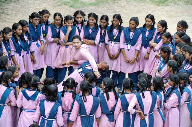 Indian Muslim international karate champion, Syeda Falak (C-L), shows self-defence techniques to students at the Telangana Minorities Residential Girls School in Hyderabad on June 17, 2019. (Photo by Noah Seelam/AFP Photo)