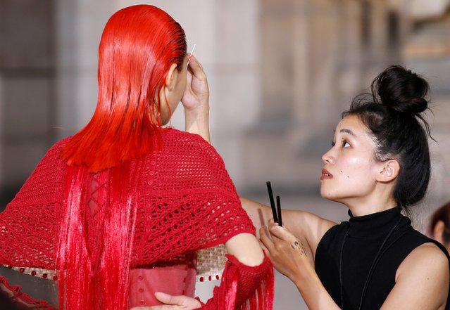 A model has her make-up applied before the Haute Couture Fall/Winter 2019/20 collection show, by designer Yuima Nakazato, in Paris, France, June 30, 2019. (Photo by Regis Duvignau/Reuters)