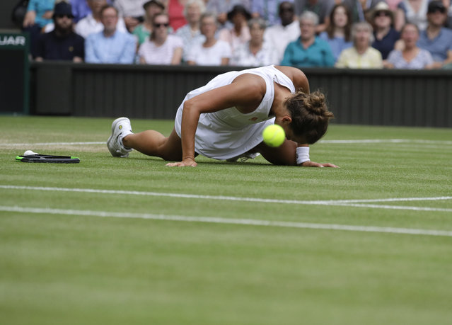 Czech Republic's Barbora Strycova falls after trying to reach the ball during a women's quarterfinal match against Britain's Johanna Konta on day eight of the Wimbledon Tennis Championships in London, Tuesday, July 9, 2019. (Photo by Kirsty Wigglesworth/AP Photo)
