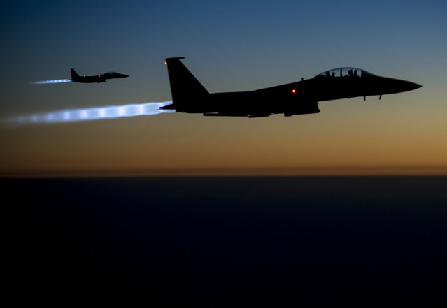 A pair of U.S. Air Force F-15E Strike Eagles fly over northern Iraq after conducting airstrikes in Syria, September 23, 2014. (Photo by Senior Airman Matthew Bruch/Reuters/U.S. Air Force)