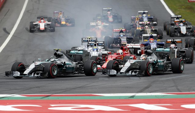 Mercedes drivers Nico Rosberg of Germany, left and Mercedes driver Lewis Hamilton of Britain, right, steer their cars on the start of the the Formula One Grand Prix race, at the Red Bull Ring in Spielberg, southern Austria, Sunday, June 21, 2015. (AP Photo/Darko Bandic)