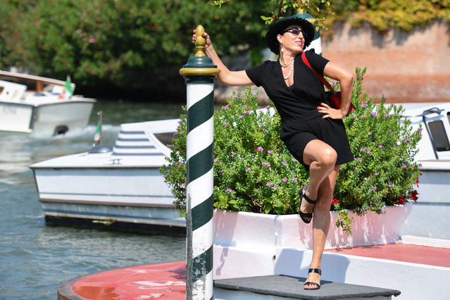 Spanish actress Rossy de Palma poses as she arrives by taxi boat at the pier of the Excelsior Hotel on August 30, 2019 during the 76th Venice Film Festival at Venice Lido. (Photo by Alberto Pizzoli/AFP Photo)