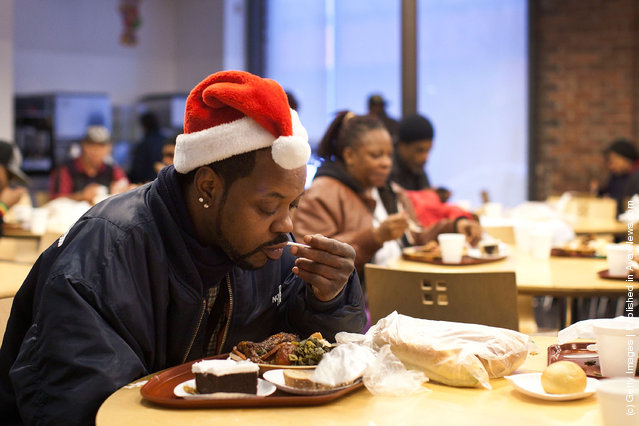 Harry Sprinkle eats a meal at St. John's Bread and Life, a free meal service in the Brooklyn borough of New York City