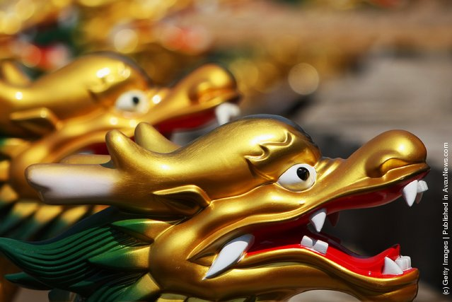Dragon Boats sit at the docks before the start of the Qinglong Lake Dragon Boats Competition