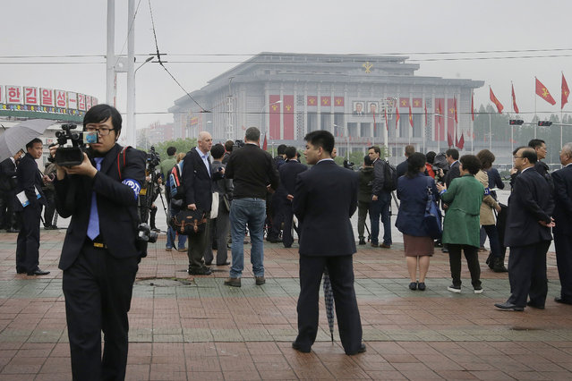 In this May 6, 2016, file photo, foreign journalists work from across the April 25 House of Culture, the venue for the 7th Congress of the Workers' Party of Korea, in Pyongyang, North Korea. (Photo by Wong Maye-E/AP Photo)