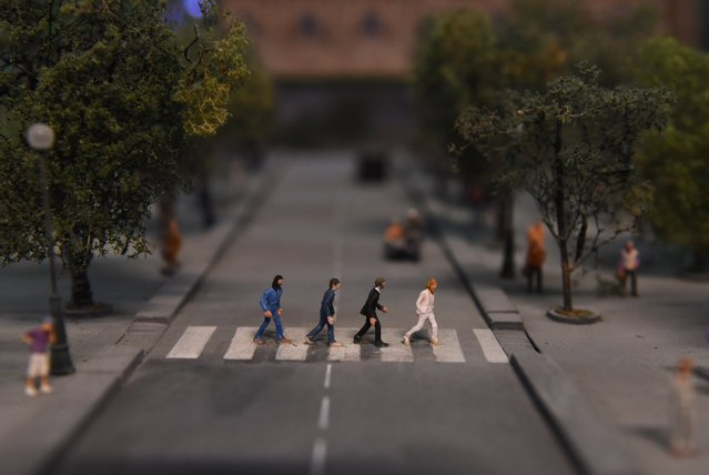 A miniature model of the iconic image, the Beatles crossing Abbey Road, part of Gulliver's Gate, a miniature world being recreated in a 49,000-square-foot exhibit space in Times Square, is seen during a preview April 10, 2017 in New York City. (Photo by Timothy A. Clary/AFP Photo)