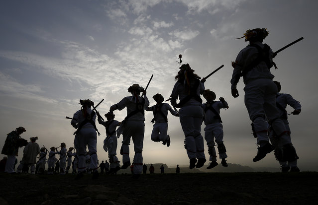 Leicester Morris Men dance at Bradgate Park in Newtown Linford, central England May 1, 2014. The May Day Morris celebration is a traditional rite thought to be connected to changing seasons and fertility. (Photo by Darren Staples/Reuters)