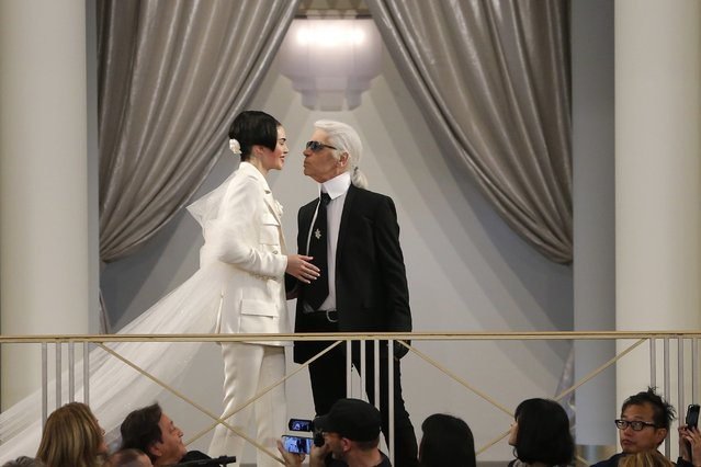 German designer Karl Lagerfeld (R) appears with U.S. model Kendall Jenner at the end of his Haute Couture Fall Winter 2015/2016 fashion show for French fashion house Chanel at the Grand Palais which is transformed into a casino in Paris, France, July 7, 2015. (Photo by Stephane Mahe/Reuters)