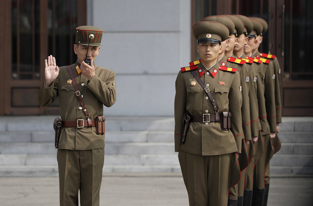 North Korean soldiers wait to march onto Kim Il Sung Square during a military parade on Saturday, April 15, 2017, in Pyongyang, North Korea to celebrate the 105th birth anniversary of Kim Il Sung, the country's late founder and grandfather of current ruler Kim Jong Un. (Photo by Wong Maye-E/AP Photo)