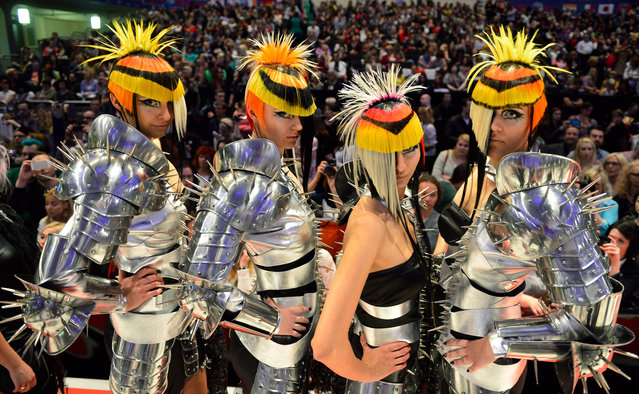 """Models walk around the catwalk after the contest """"Full Fashion Look"""" during the OMC Hairworld World Cup on May 4, 2014 in Frankfurt am Main, Germany. (Photo by Thomas Lohnes/Getty Images)"""