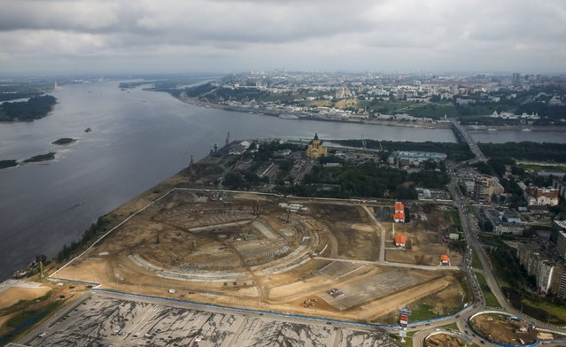 An aerial view of the construction site of the new soccer stadium in Nizhny Novgorod, Russia, July 10, 2015. (Photo by Maxim Shemetov/Reuters)